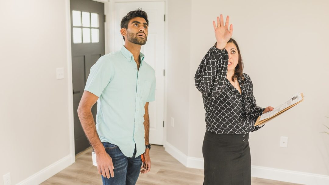 real estate agent showing a potential homeowner a property